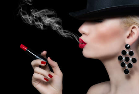 Beautiful girl with cigarette and red lips on black background  Stock Photo