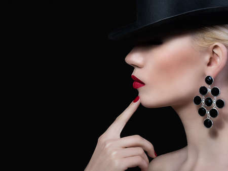 Beautiful girl with red lips and manicure on black background 版權商用圖片