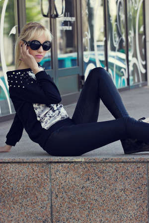 Beautiful blonde girl in black sunglasses photo