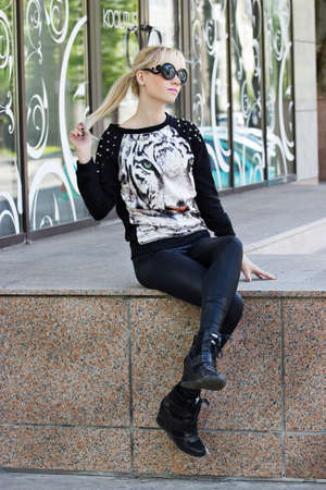 Beautiful blonde girl in pullover with tiger print photo