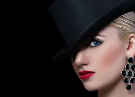Beautiful blonde woman with red lips on black background