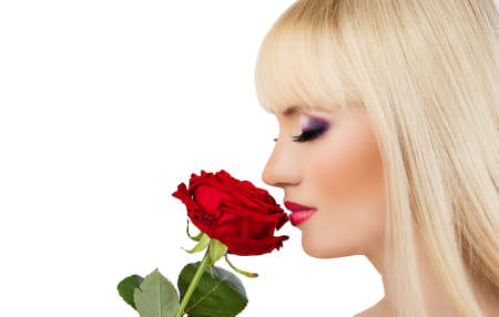 Beautiful blonde girl with red rose on white background photo