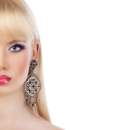 earings: Portrait of beautiful blonde girl with purple makeup on white background