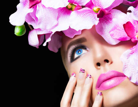 Beautiful girl with flowers and perfect makeup on black background Stock Photo
