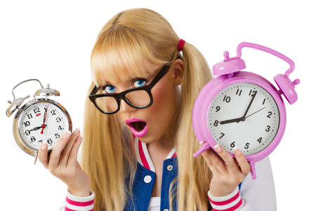 Surprised student girl with clock on white background photo