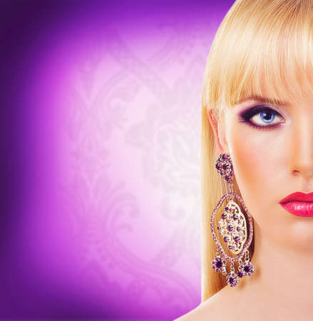 Portrait of beautiful blonde girl with purple makeup photo