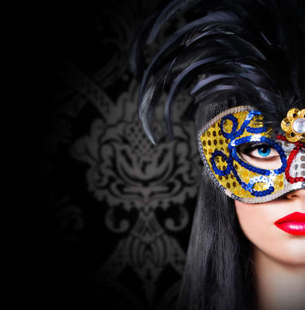 Beautiful model in carnival mask with red lips photo