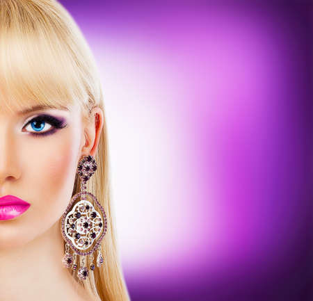 Beautiful blonde girl with purple makeup photo
