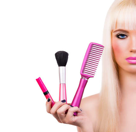 Beautiful girl with makeup brushes on white background  photo