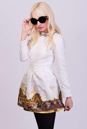 Beautiful blonde girl in elegant dress on grey background Stock Photo - 28758650