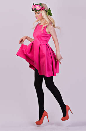 Beautiful blonde model posing in elegant dress in the studio on grey background Stock Photo - 28758651