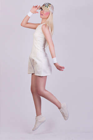 Beautiful blonde model posing in white dress in the studio Stock Photo - 28758653