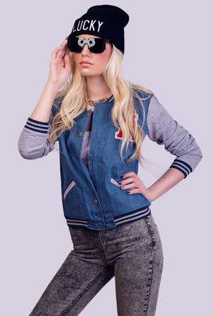 Beautiful blonde girl posing on grey background Stock Photo - 28758654