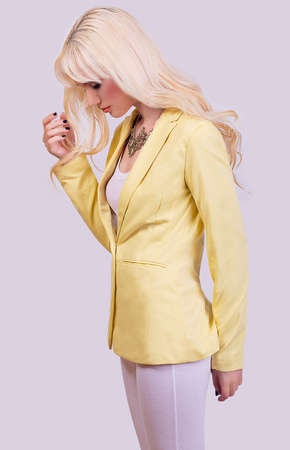Beautiful fashionable blonde model posing on grey background Stock Photo - 28758655