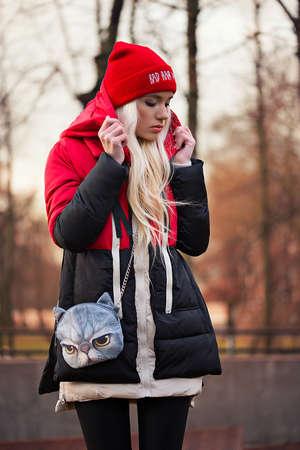 Fashion beautiful woman with bag outdoors photo