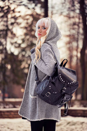 Fashion beautiful woman with backpack outdoors