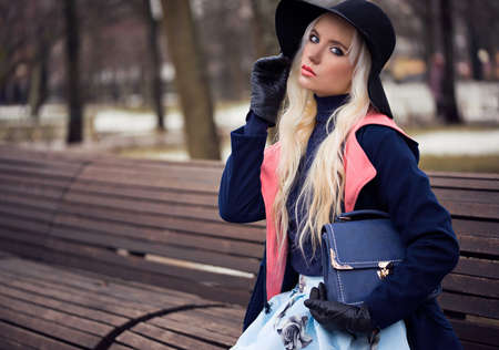 Fashion beautiful woman with bag outdoors