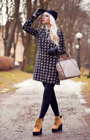 Fashion woman with bag outdoors photo
