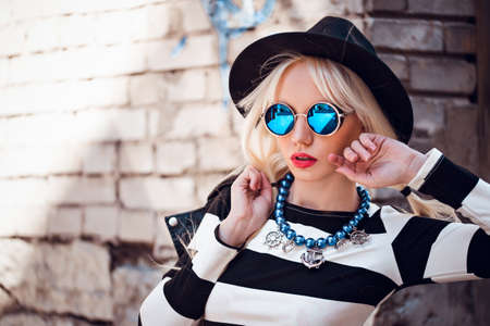 Beautiful girl in sunglasses outdoors 写真素材