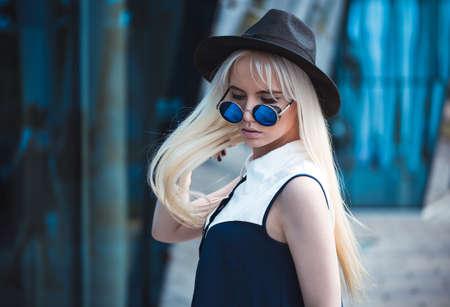 Beautiful girl in sunglasses outdoors Stock Photo