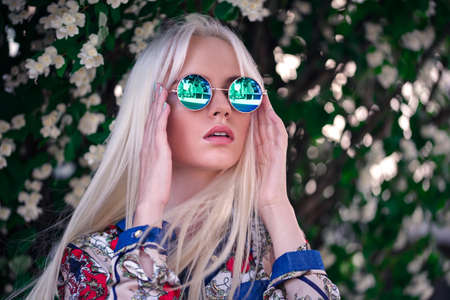 sunglass: Beautiful girl in sunglasses outdoors Stock Photo