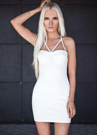 Beautiful blonde model posing outdoors photo