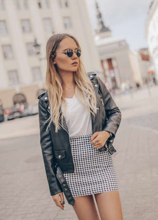 Stylish woman posing in outdoor