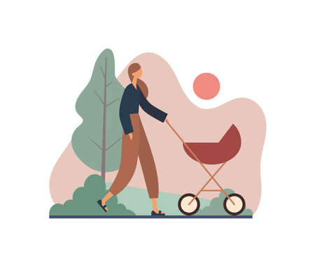 Mother walking with stroller during sunset. Modern woman in casual clothes pushing baby carriage and walking along path near tree and bushes during sunset in calm summer evening in park