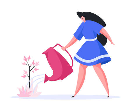 Happy modern female gardener in casual blue dress smiling and watering tree seedling while caring about nature and working in garden on summer day