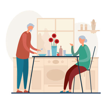 Elderly couple having lunch together at home