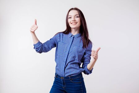 woman hands up: happy girl shows sign of good class Stock Photo