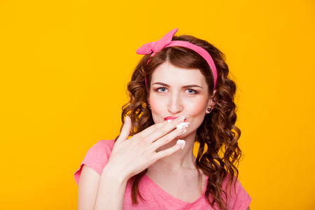 fingers: girl licks cream off fingers Stock Photo