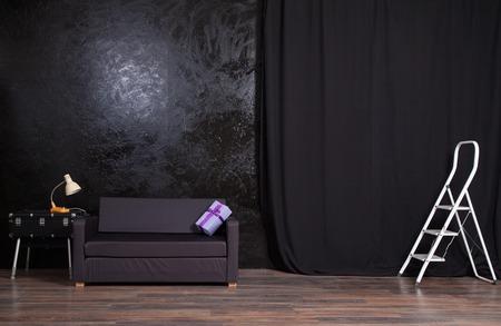 photo studio: Photo Studio black wall background with sofa Stock Photo
