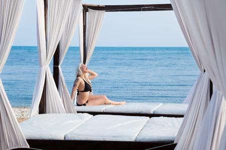 sunning: beautiful woman in bathing suit sunning on the beach