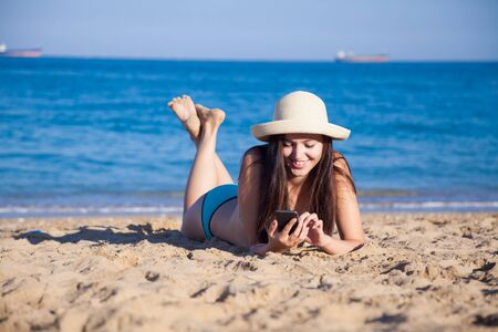 the girl in the hat Tan on the beach Stock Photo