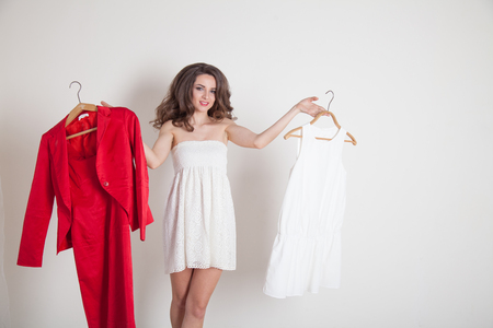 preference: a girl chooses between red and white Stock Photo