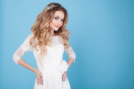 bride in wedding dress on a blue background Stock Photo