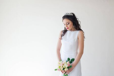 blondie: bride in white wedding dress with a bouquet of flowers