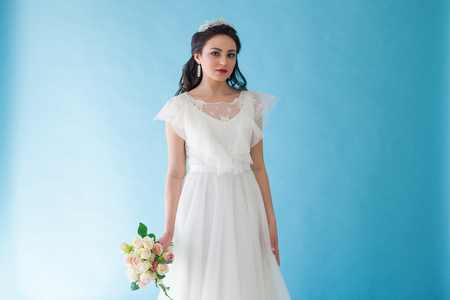 Princess Bride in a white dress with a Crown on a blue background