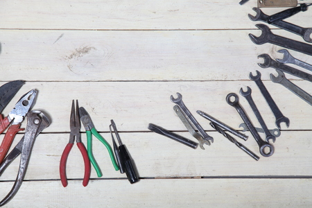 garage on house: construction hammers screwdriver repair tool pliers on the white boards
