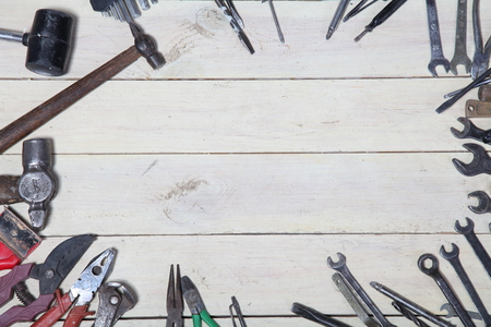wooden floors: construction hammers screwdriver repair tool pliers on the white boards