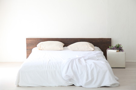 nightstand: White bedroom bright interiors with bed
