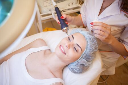 makes: Cosmetology doctor makes the procedure a woman face cleaning