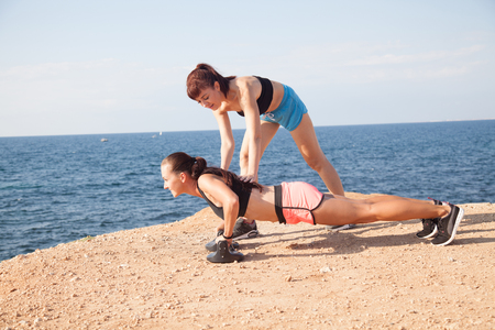 aspirational: woman goes in for Sports Fitness on the beach