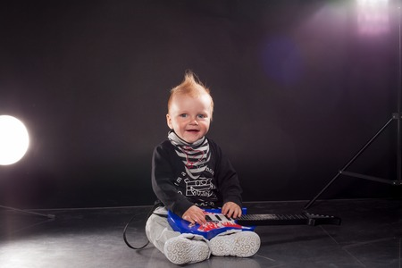 hardrock: little boy musician playing rock music on the guitar Stock Photo
