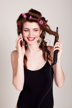 specific clothing: girl with hair curlers talking on the phone and makes the hairstyle