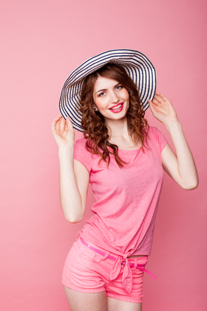 navy blue background: the girl in the hat on a pink background
