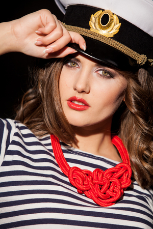 a girl in a cap style fashion pinup Stock Photo