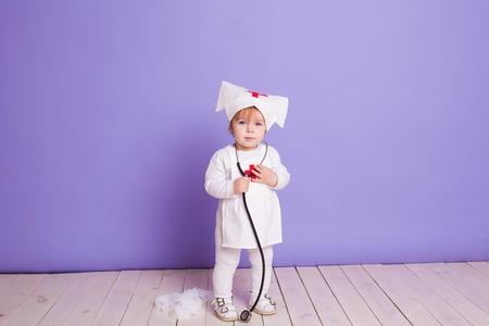little girl plays in the hospital nurse Stock Photo