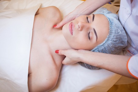 doctor cosmetologist doing facial massage girl spa